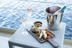 Cheese and champagne on the Zambezi Queen by ZQ Collection