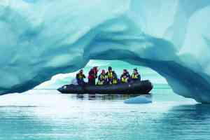 Photographing icebergs, Antarctica by Aurora Expeditions