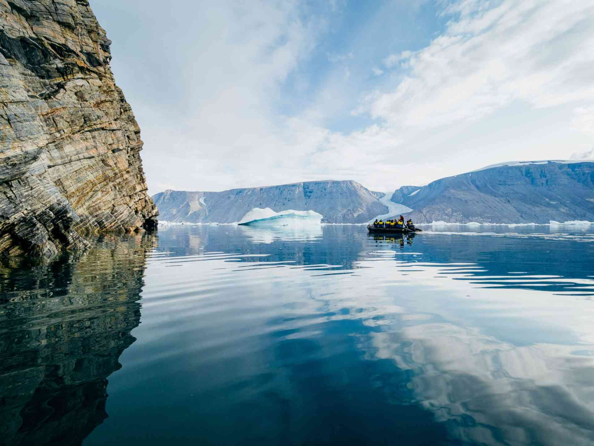 Zodiac cruise through the picturesque mountain landscape by Aurora Expeditions