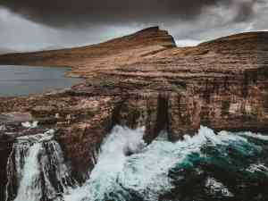 Sheer cliffs of the Faroe Islands by Aurora Expeditions