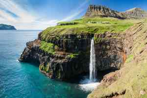 Majestic waterfall on Faroe Islands by Aurora Expeditions