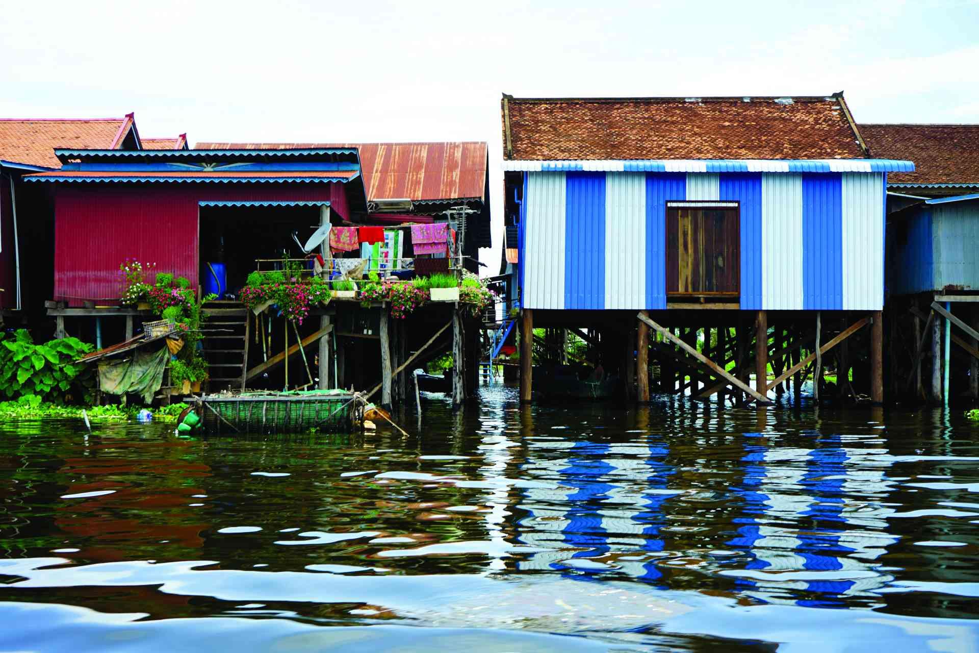 Stilt houses, Tonle Sap by Priscilla Aster