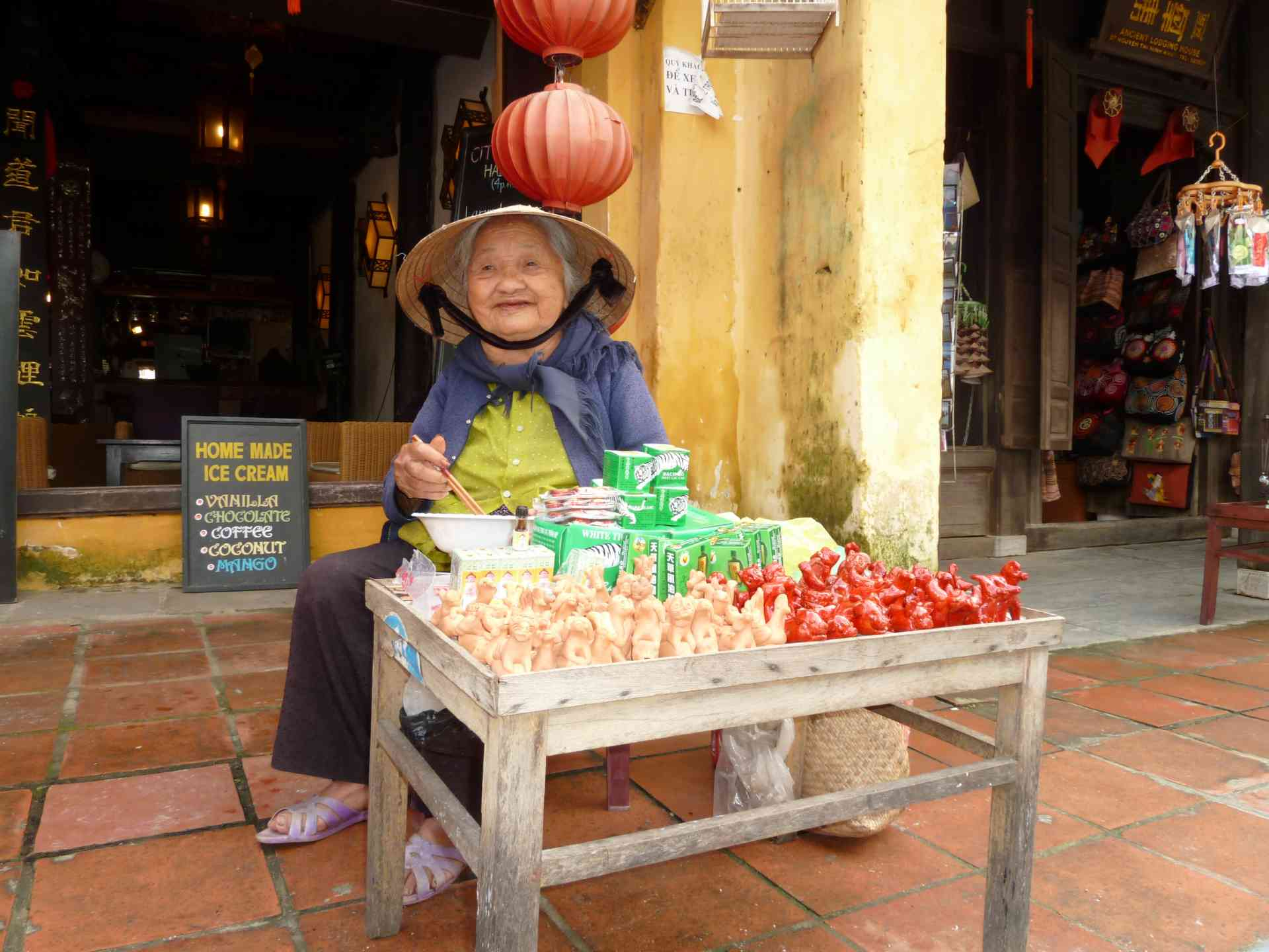 Local seller in Hanoi, Vietnam by Dennis Bunnik