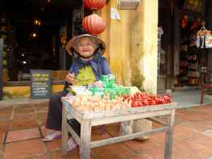Local seller in Hanoi, Vietnam by Dennis Bunnik