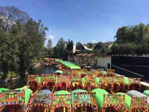 Trajineras in Xochimilco, Mexico by Honi Gibson