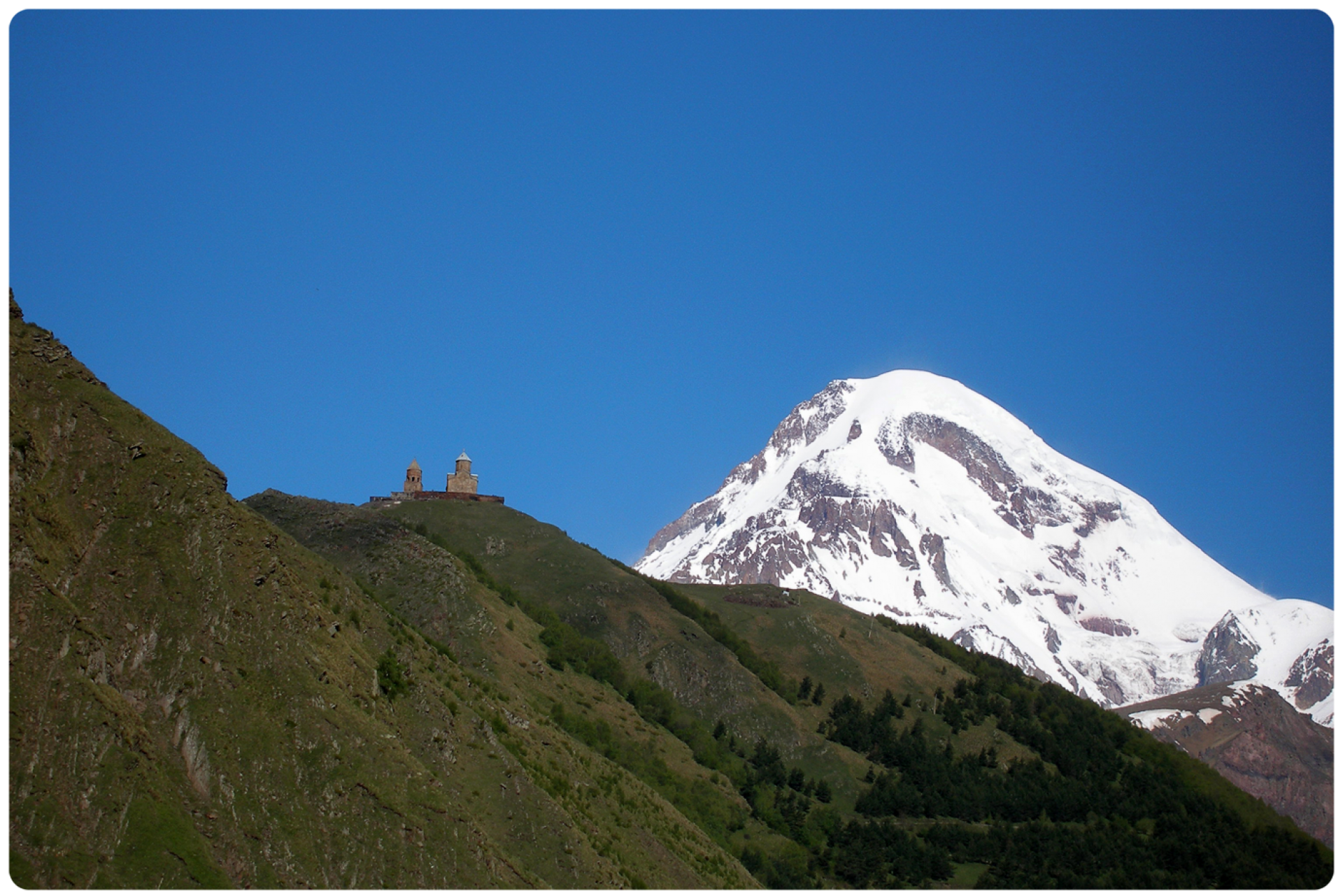 Mt. Kazbegi and Gergeti Church, Georgia by Nene Samnashvili