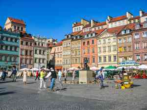 Warsaw Old Town Market Square, Poland by Rita Junkere