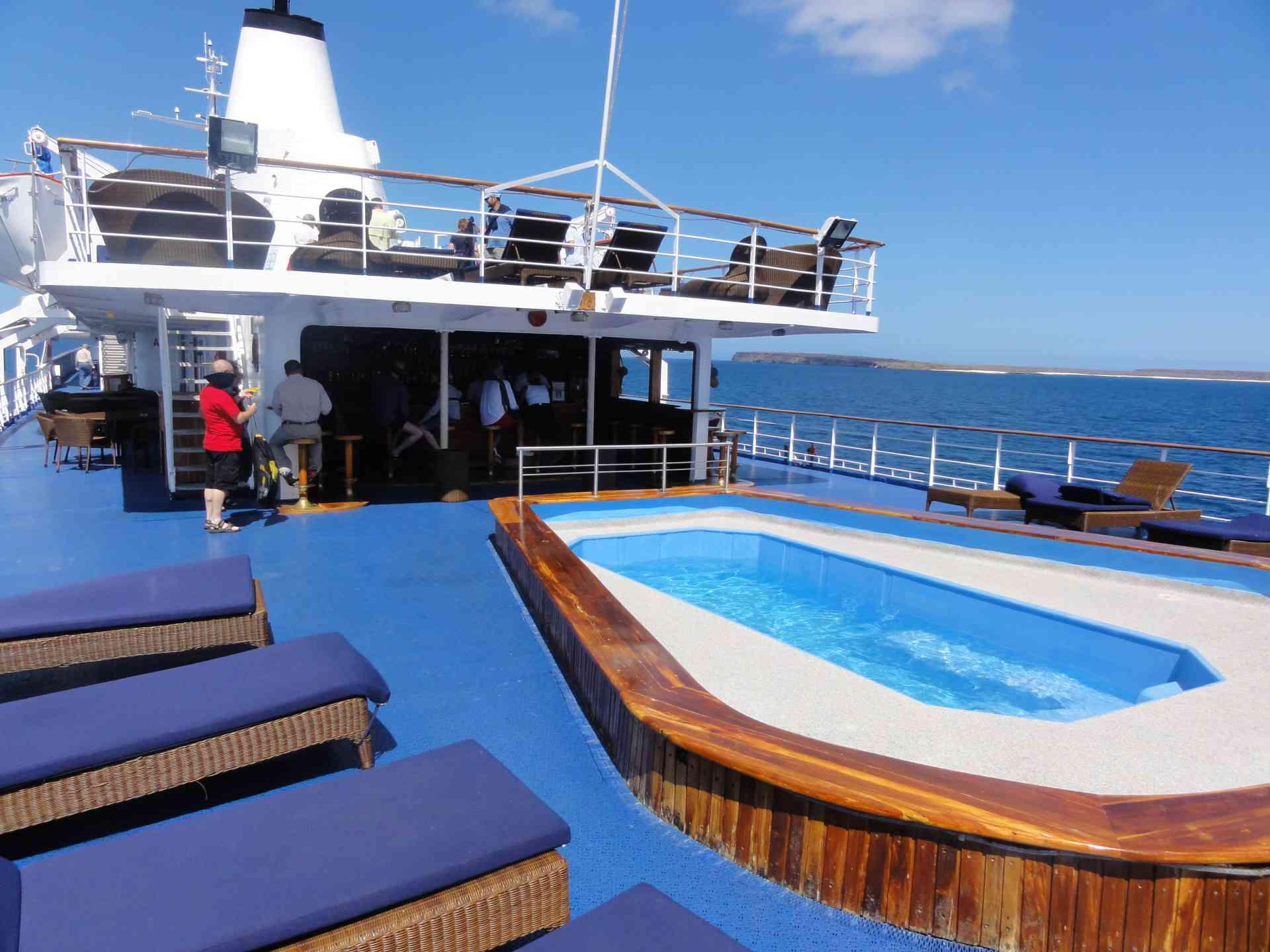 The pool & sun terrace on board the Galapagos Legend, Ecuador by Jeremy van Heerde