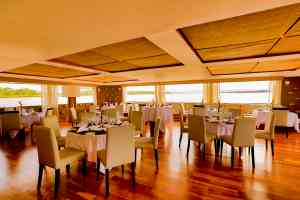 Delfin III cruise ship dining room, Peru by Delfin Amazon cruises